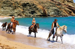 Explore the island of Mykonos by riding a horse. Do Horseback Riding and access secluded beaches.