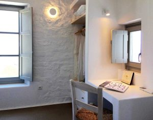 The Villa Chora Deluxe bedroom with desk and chair. A Luxury villa in Chora, Mykonos.