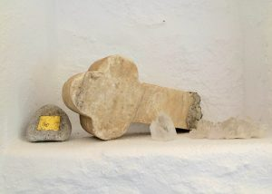 A marble cross on a wall at the Villa Chora Deluxe. A Luxury villa in Chora, Mykonos