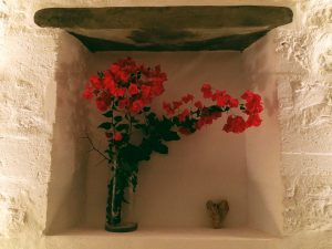 Small details of the Villa Chora Deluxe. A Luxury villa in Chora, Mykonos. Red flowers in a vase.