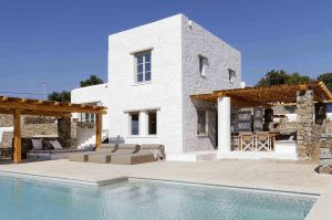 Swimming pool and building exterior of the Villa Chora Deluxe. A Luxury villa in Chora, Mykonos