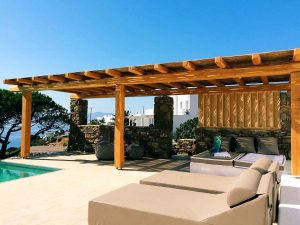 Pergola, sun loungers and swimming pool of the Villa Chora Deluxe. A Luxury villa in Chora, Mykonos