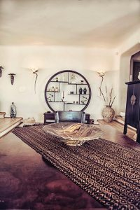 The Villa Italiana sitting room with ethnic furniture. A luxury villa in Mykonos with sea view.