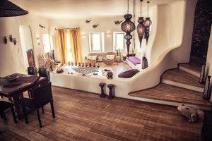 The luxury Villa Italiana open plan sitting and dining room. A luxury villa in Mykonos with sea view