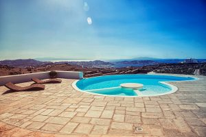 The luxury Villa Italiana bean shaped swimming pool. A luxury villa in Mykonos with sea view.