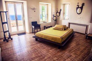 The luxury Villa Italiana bedroom with ethnic decor. A luxury villa in Mykonos with sea view.