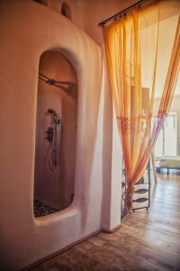 The luxury Villa Italiana shower with ethnic decor. A luxury villa in Mykonos with sea view.