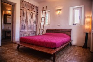 The luxury Villa Italiana bedroom with ethnic decor. A luxury villa in Mykonos with sea view.