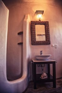 The luxury Villa Italiana bathroom basin, mirror & shower. A luxury villa in Mykonos with sea view.