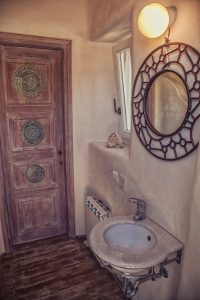 The luxury Villa Italiana bathroom basin and mirror. A luxury villa in Mykonos with sea view.