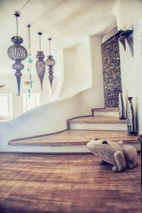 Stairs leading down to the Villa Italiana living area. A luxury villa in Mykonos with sea view