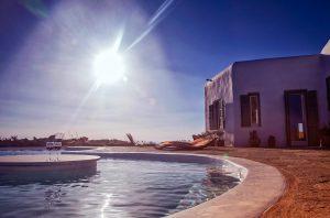 The luxury Villa Italiana bean shaped swimming pool. A luxury villa in Mykonos with sea view.