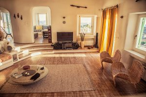 The luxury Villa Italiana living room with ethnic furniture. A luxury villa in Mykonos with sea view