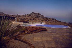 Ethnic design Sun loungers of the luxury Villa Italiana. A luxury villa in Mykonos with sea view.