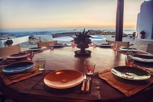 Dinner table with sea view at the luxury Villa Italiana. A luxury villa in Mykonos with sea view.