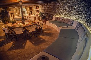 Round sofas and round table at the luxury Villa Italiana. A luxury villa in Mykonos with sea view.