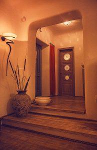 The luxury Villa Italiana entrance hall with ethnic decor. A luxury villa in Mykonos with sea view