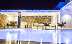 Swimming pool of the Villa Onar & Villa Cloud Luxury retreats in Mykonos by night.