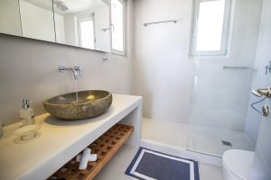 The Villa Onar & Villa Cloud Luxury retreats in Mykonos bathroom sink, toilet and shower.