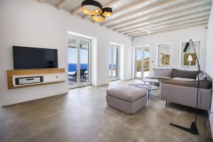 The Villa Onar & Villa Cloud Luxury retreats in Mykonos spacious living room area with TV.