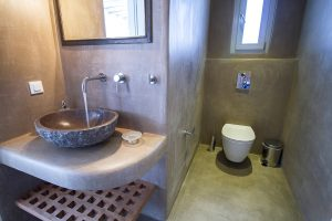 The Villa Onar & Villa Cloud Luxury retreats in Mykonos bathroom sink and toilet.