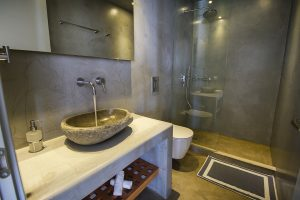 The Villa Onar & Villa Cloud Luxury retreats in Mykonos bathroom sink and shower.