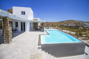 Exterior and swimming pool of the Villa Onar & Villa Cloud Luxury retreats in Mykonos by Just White.