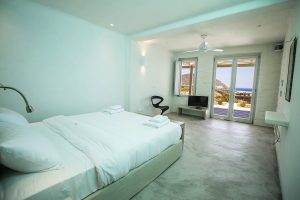 The Villa Onar & Villa Cloud Luxury retreats in Mykonos bedroom with double bed and windows.