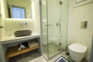 The Villa Onar & Villa Cloud Luxury retreats in Mykonos bathroom sink, toilet and shower.