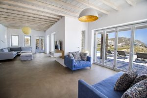 The Villa Onar & Villa Cloud Luxury retreats in Mykonos spacious living room area with sofa.