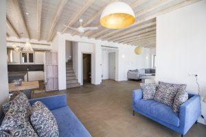 The Villa Onar & Villa Cloud Luxury retreats in Mykonos spacious living room area with sofa.