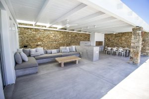 The Villa Onar & Villa Cloud Luxury retreats in Mykonos outside sitting area with sofas and tables.