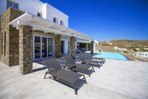 The Villa Onar & Villa Cloud Luxury retreats in Mykonos sun loungers and swimming pool.