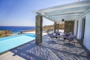 The Villa Onar & Villa Cloud Luxury retreats in Mykonos outside sitting area next to swimming pool.