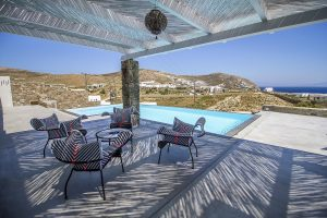 The Villa Onar & Villa Cloud Luxury retreats in Mykonos outside sitting area next to swimming pool.