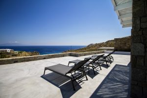 The Villa Onar & Villa Cloud Luxury retreats in Mykonos sun loungers and sea view.