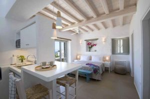 The Villa Chora Deluxe open plan kitchen and bedroom with view. A Luxury villa in Chora, Mykonos.