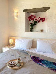 The Villa Chora Deluxe bedroom with breakfast in double bed. A Luxury villa in Chora, Mykonos.