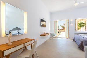 Villa Sotavento VIP luxury villa retreat in Mykonos bedroom with double bed, desk and mirror.