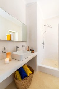 Villa Ftelia luxury villa retreat in Mykonos bathroom with wash basin, mirror and shower.
