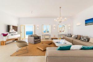 Villa Sotavento VIP luxury villa retreat in Mykonos sitting room with sofas, coffee table and tv.