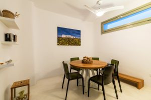 Villa Sotavento VIP luxury villa retreat in Mykonos corner with round table and 4 chairs.