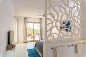 Villa Sotavento VIP luxury villa retreat in Mykonos bedroom with double bed, tv and window.