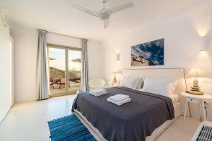 Villa Sotavento VIP luxury villa retreat in Mykonos bedroom with double bed, bedside table and fan.
