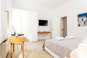 Villa Sotavento VIP luxury villa retreat in Mykonos bedroom with double bed, desk and tv.