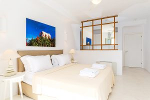 Villa Sotavento VIP luxury villa retreat in Mykonos bedroom with double bed and bedside table.