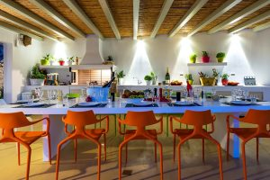 Villa Ftelia luxury villa rental in Mykonos outdoor dinning space. Dining table and chairs.
