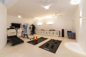 Villa Sotavento VIP luxury villa retreat in Mykonos gym with weights, and gymnastics machines.