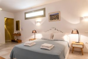 Villa Sotavento VIP luxury villa retreat in Mykonos bedroom with double bed and bedside tables.