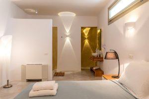 Villa Sotavento VIP luxury villa retreat in Mykonos bedroom with double bed and bedside table.
